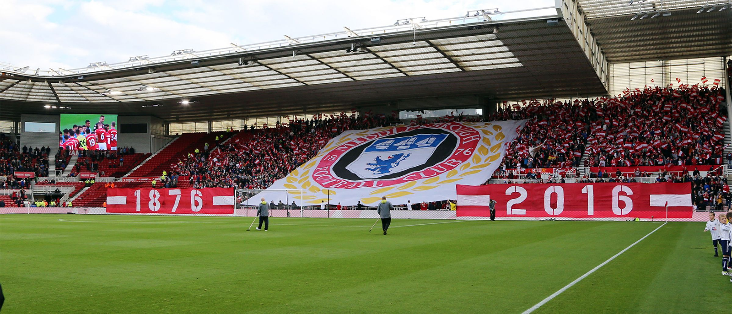 A large banner display in the South Stand