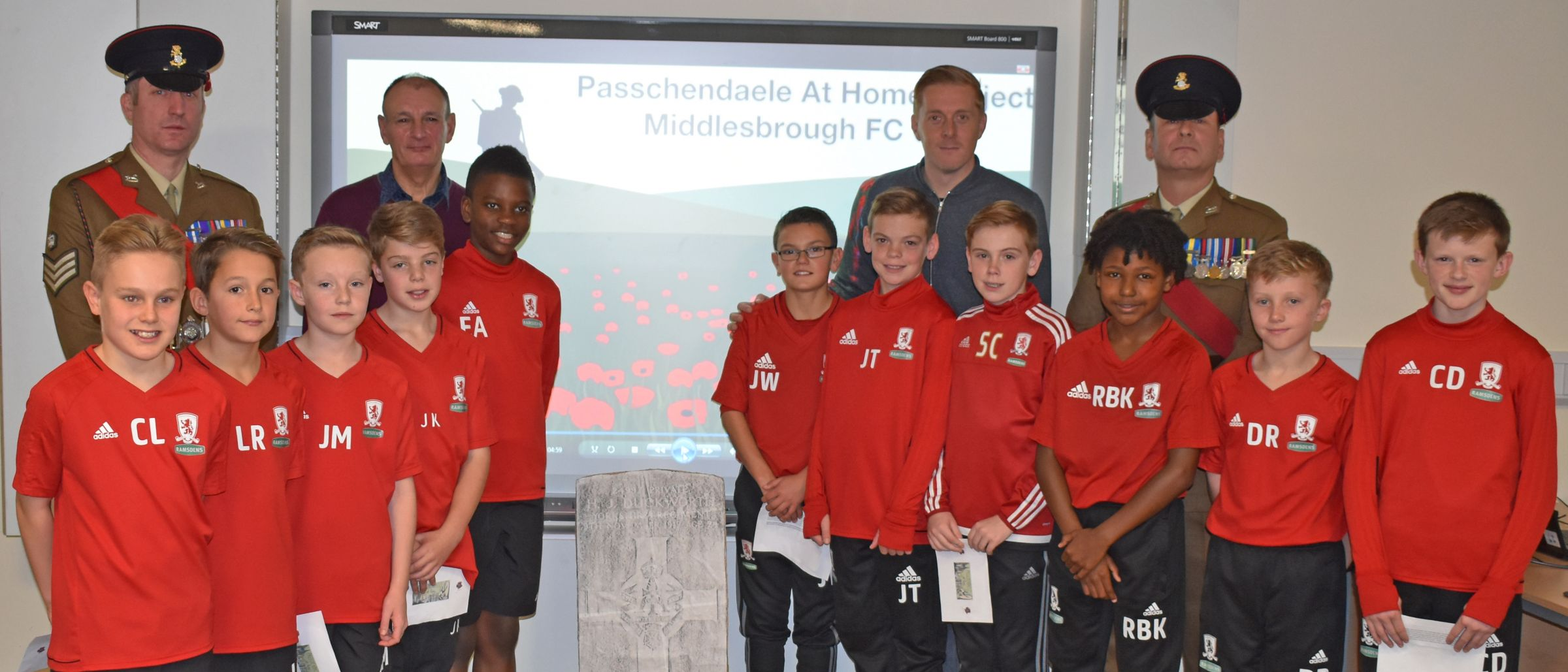 Middlesbrough FC manager Garry Monk with members of the Academy's U12s, two members of the Yorkshire Regiment and Eric Taylor, great newphew of Private James Duckworth who died as a result of injuries suffered at Passchendaele and is buried in Eston Cemetery