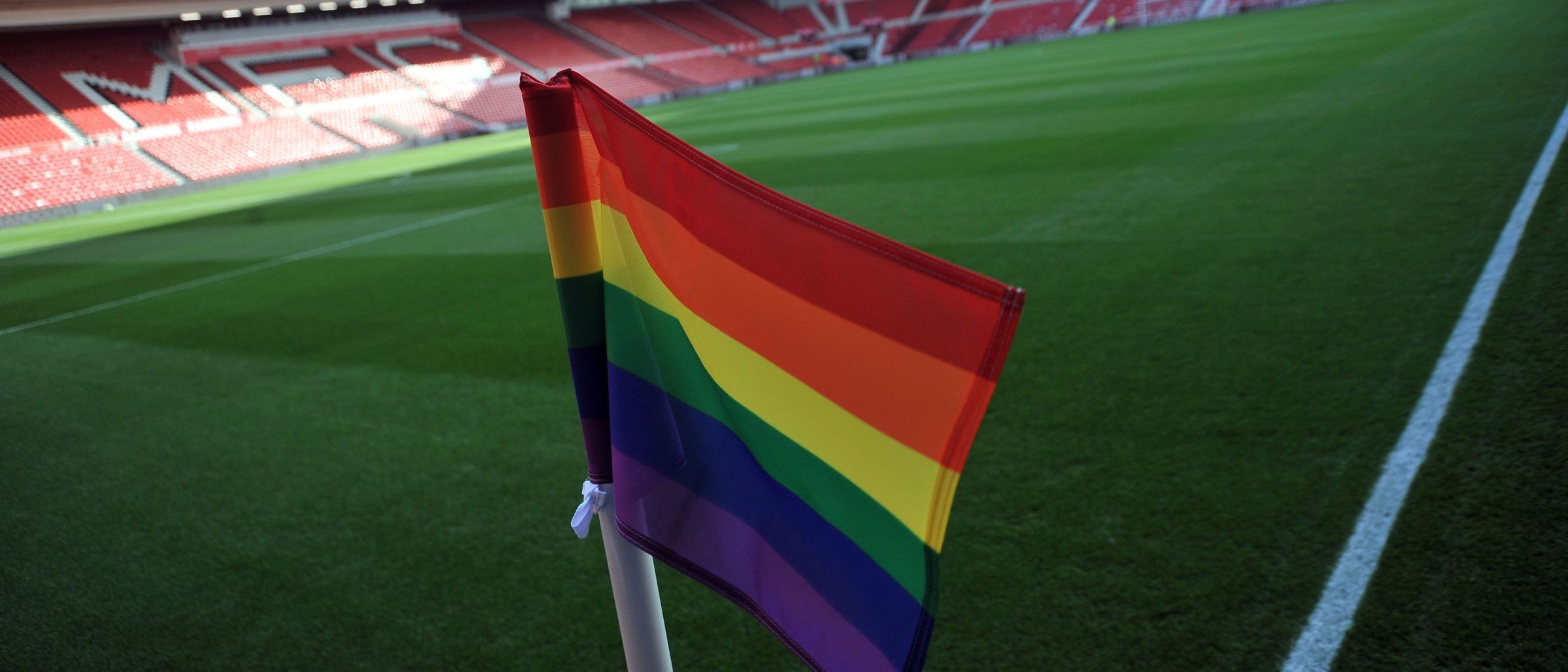 Rainbow corner flags at the Riverside