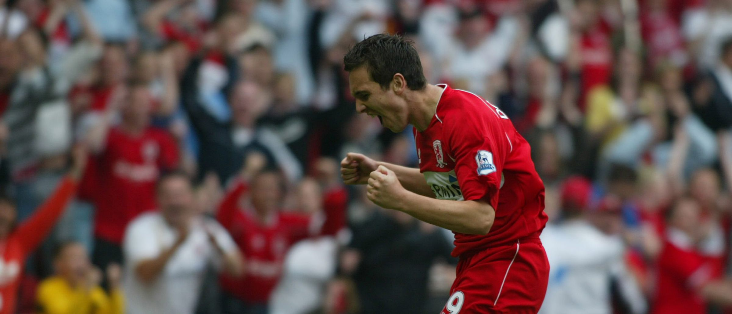Stewart Downing celebrates scoring against Manchester City