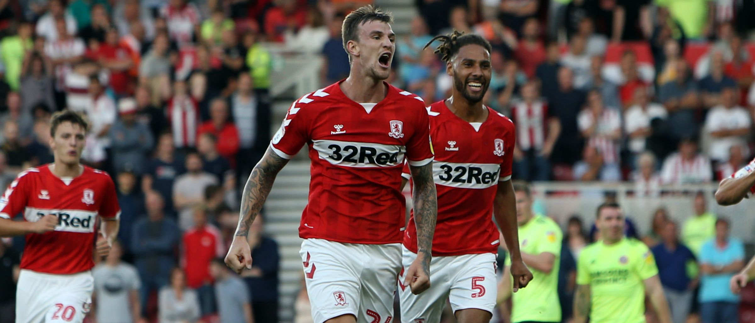 Aden Flint roars away in celebration as he heads home his first Boro goal