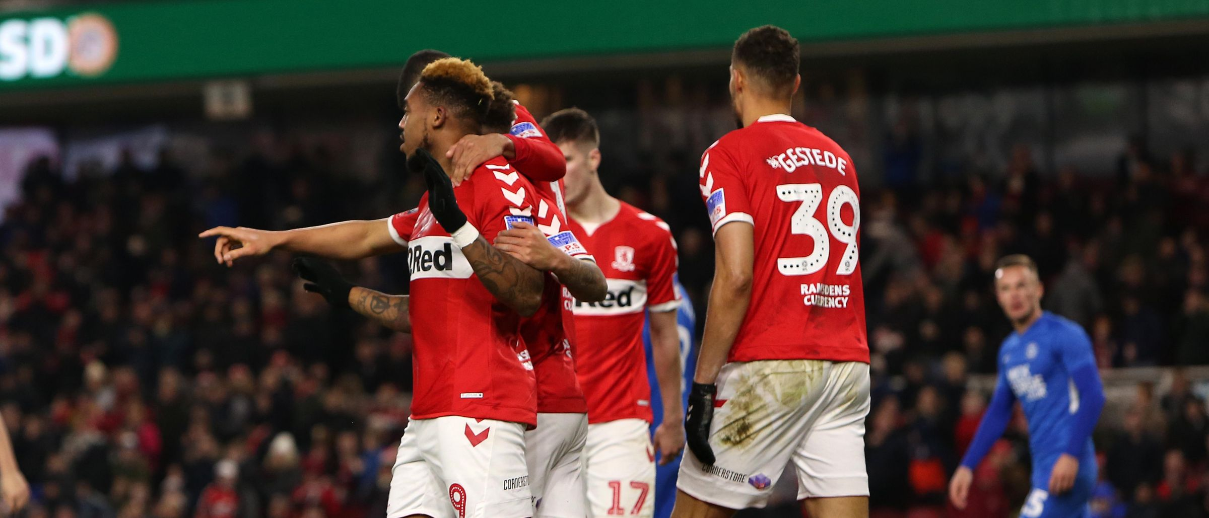 Britt is robbed by his teammates as he scores Boro's first goal