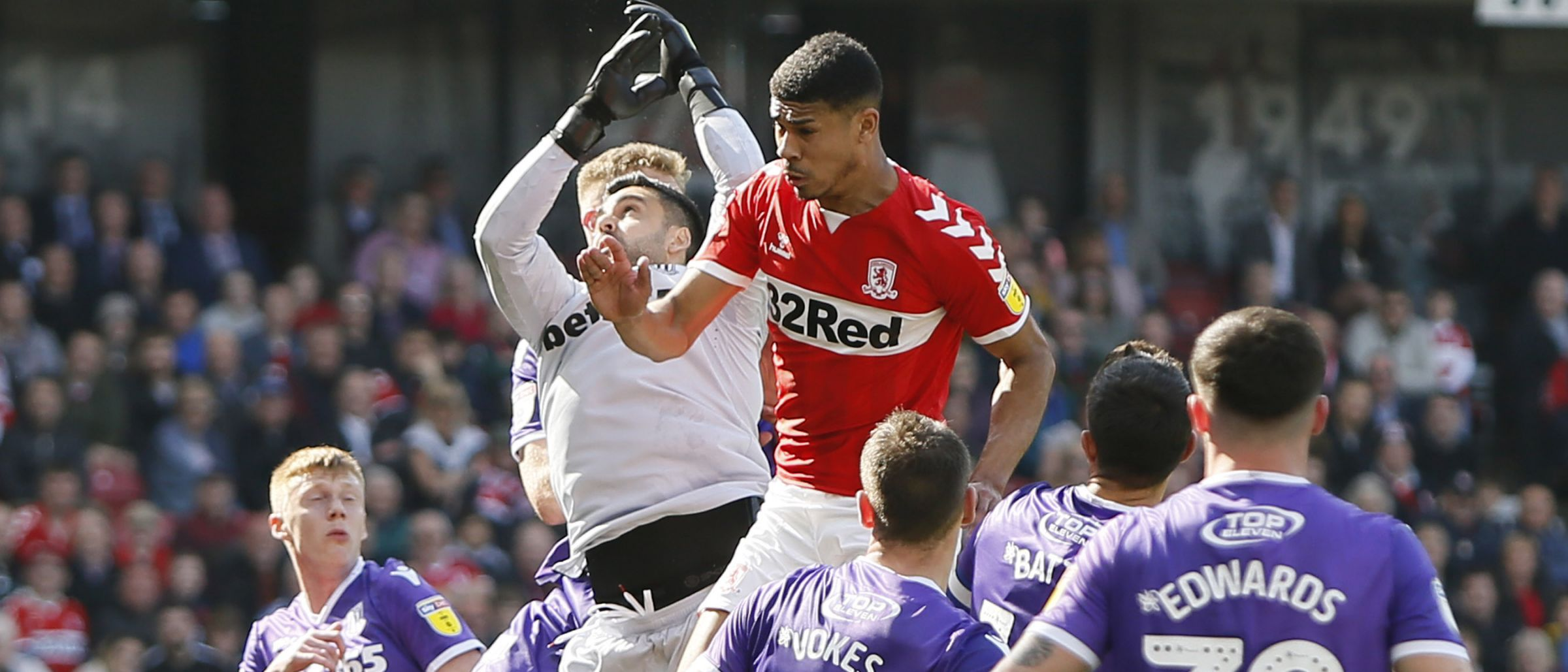 Ashley Fletcher catches some serious air as he forces Stoke's Adam Federici into a spill