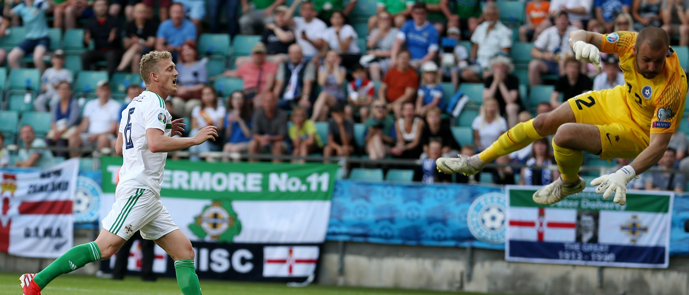 Middlesbrough FC's George Saville, left, playing for Northern Ireland against Estonia