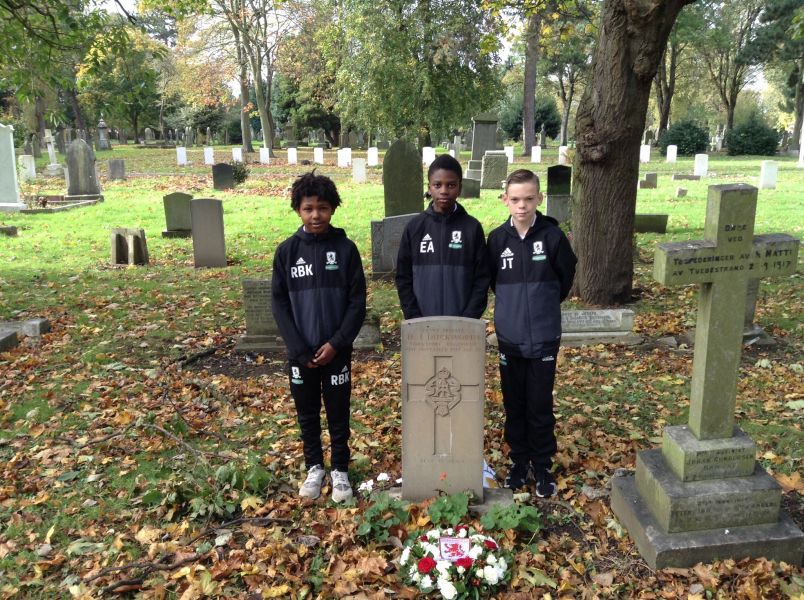 Three youngsters from Middlesbrough FC's U12s, L-R Rio Kerr, Ezra Amadi-Emina and Jacob Thompson having laid a wreath on the grave of Private 24997 HJ Duckworth in Eston Cemetery. Private Duckworth died as a result of injuries suffered at Passchendaele